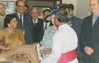 A carpet being presented to HM Queen Elizabeth II (1997).